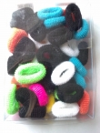Pony tail toweling covered elastics assorted colours in each pack of 45